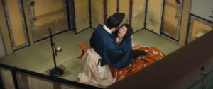 photo of a young man and woman from 10th Century Japan embracing