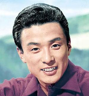 Photo of a 1950s Japanese man smiling, looking at the camera