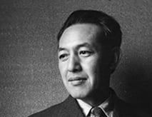 Photo of Uchida Tomu and a suit and tie in the 1940s