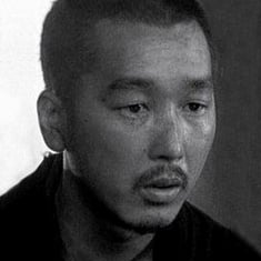 Portrait of the solemn face of a Japanese man, the actor Chiaki Minoru
